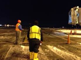 Carl Mosley, Manager (left) and Tony Melton (right) ready to park the taxiing aircraft at Gate A6.