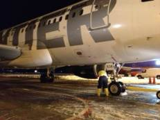 Chocking the nose gear tires and getting ready to download the Trenton flight.